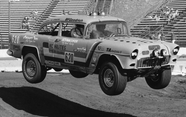 """Off-road"" racing--in a '55 Chevy sedan--inside a stadium."